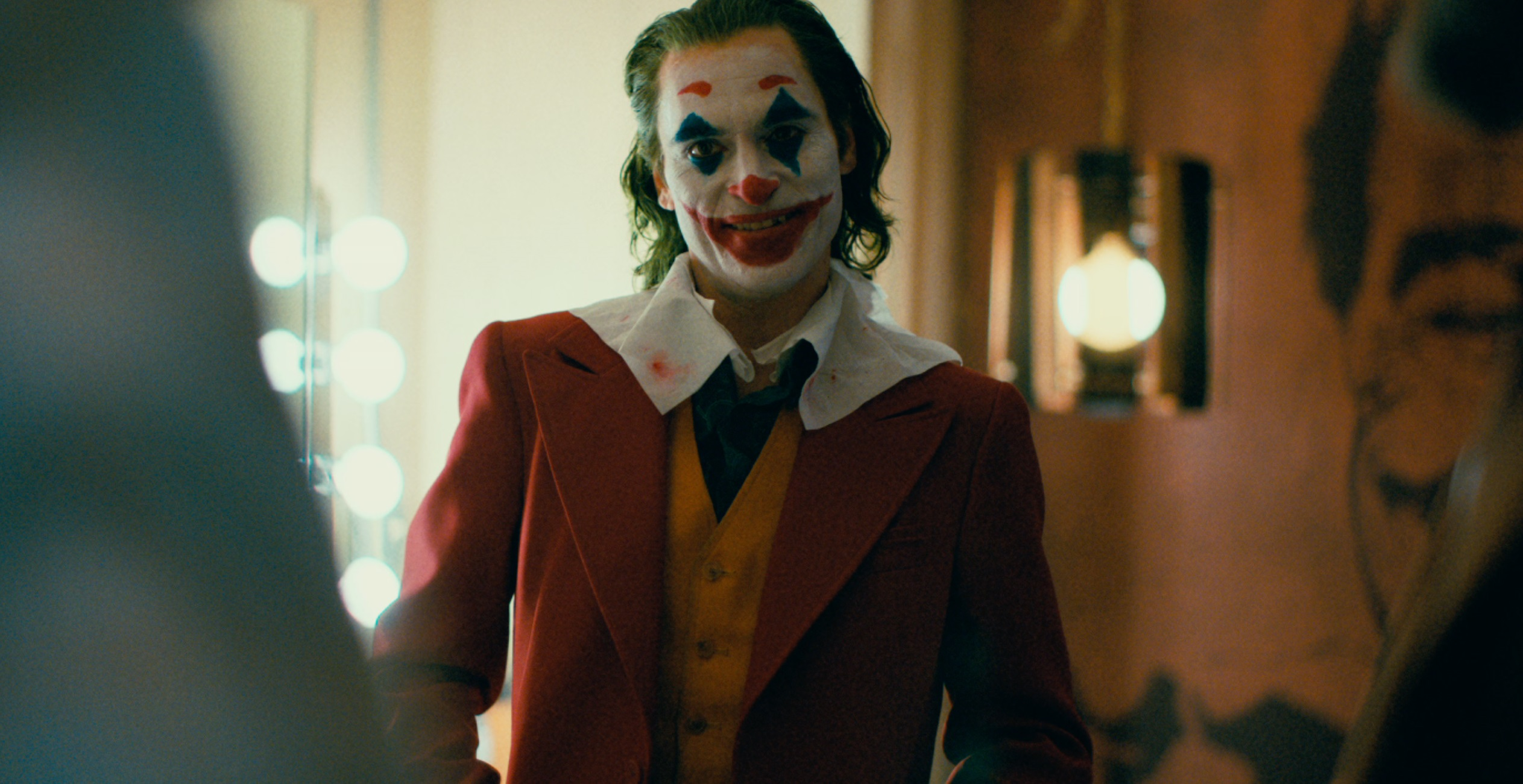 Joaquin Phoenix Dances And Smiles In New Joker Posters Dc