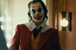 Joaquin Phoenix Dances and Smiles in New Joker Posters
